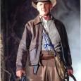 HARRISON FORD [Indiana Jones] Photo présentée sous passe partout 24 x 30 cm avec signature autographe 150€